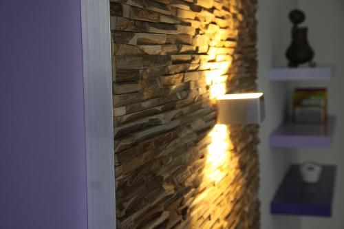 Wandverkleidung Holz Paneele modern teak